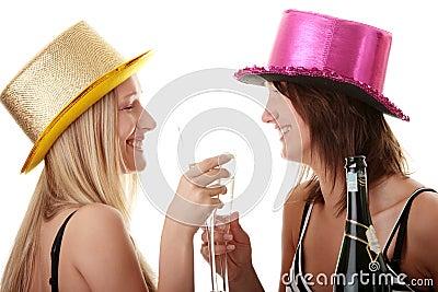 Two casual young women enjoying champagne
