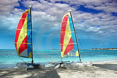 Two catamarans on a beach