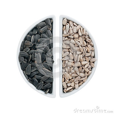 Two ceramic plates with sunflower seeds