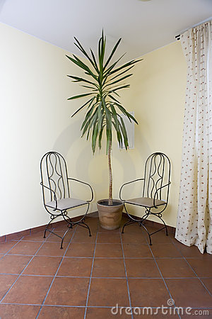 Two chairs in corner