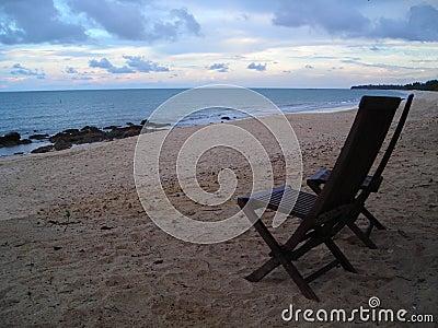 Two chairs facing beach in Desaru, Malaysia