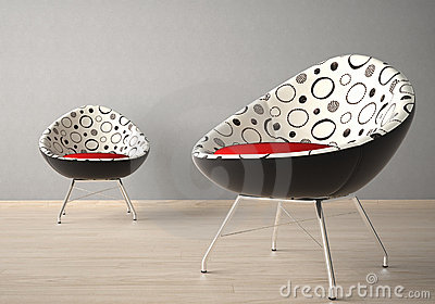 Two chairs on a grey wall