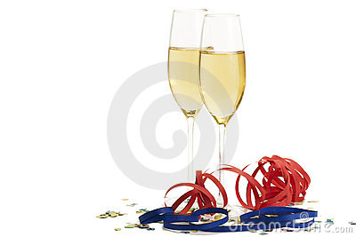 Two champagne glasses with blow-outs and confetti