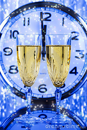 Two Champagne glasses and clock
