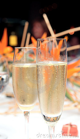 Two Champagne glasses filled with alcohol