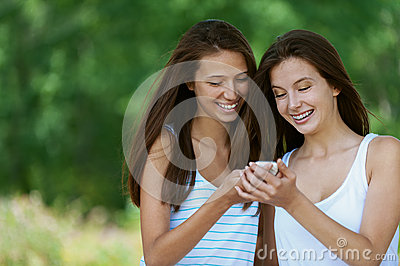 Two charming girls reads message