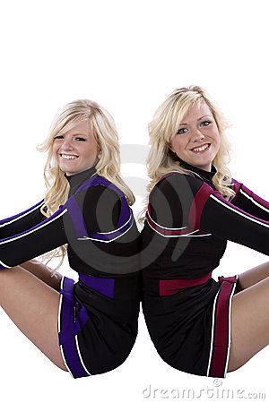 Two cheerleaders closeup back to back