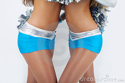 Two cheerleaders in silver-blue outfit.
