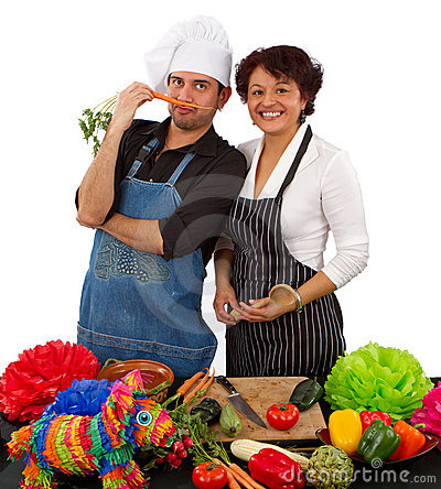 Two chefs preparing for a celebration