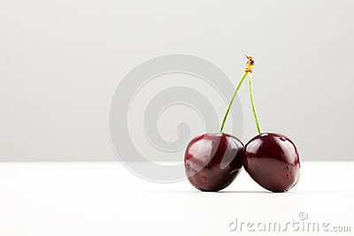 Two cherries on joined stalk
