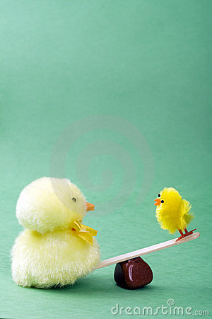 Two chicks on a see saw