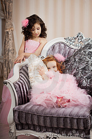Two children on a chair in a nice dress
