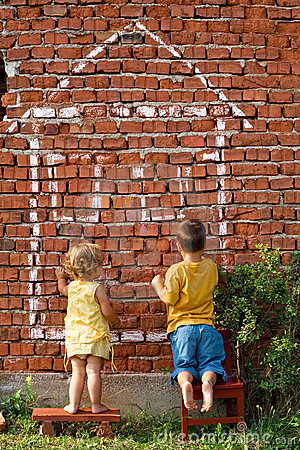 Two children drawing a house