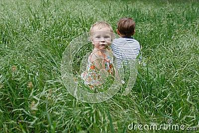 Two children in grass