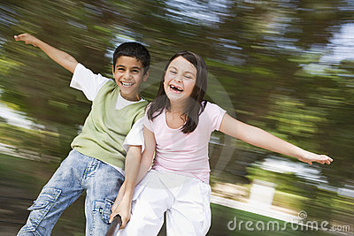 Two children having fun on roundabout