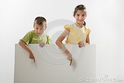 Two children holding a blank sign
