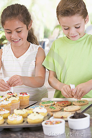 Free Two Children In Kitchen Decorating Cookies Royalty Free Stock Image - 5939266