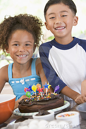 Free Two Children In Kitchen With Birthday Cake Stock Photo - 5939260