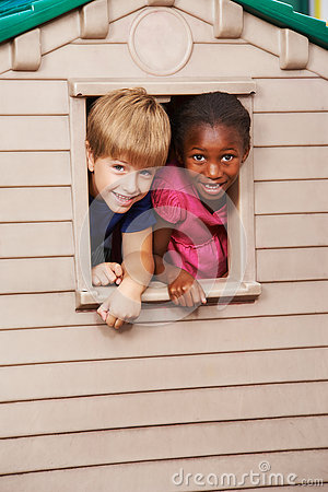 Free Two Children Looking Through Window In Playhouse Stock Images - 79264914