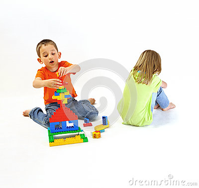 Two children playing with a constructor