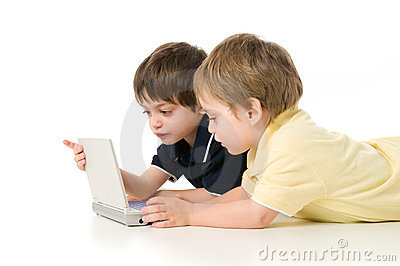 Two children playing with the laptop
