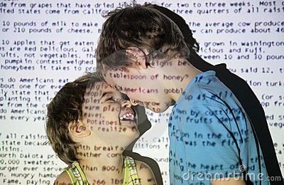Two children an projection text