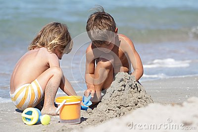 Two children on sand beach
