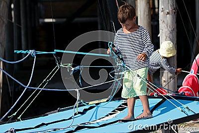 Two children on sea catamaran / yacht
