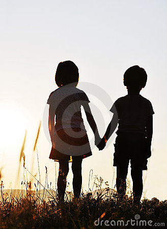 Two children sunset romantic