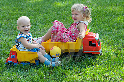 Two children on trucks
