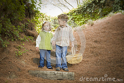 Two Children Walking Down Wood Steps with Basket