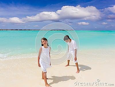 Two children on white sand
