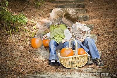 Two Children on Wood Steps with Pumpkins Playing