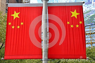Two China flags on Shanghai lamppost