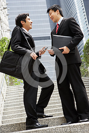 Two Chinese Businessmen Having Discussion