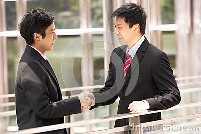 Two Chinese Businessmen Shaking Hands