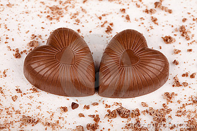 Two chocolate hearts with crumbs