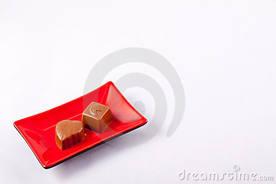Two Chocolates on a Square Plate
