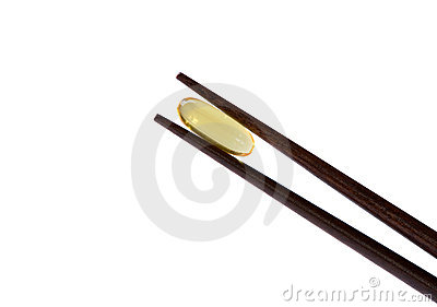 Two chopsticks holding  omega-3 vitamin