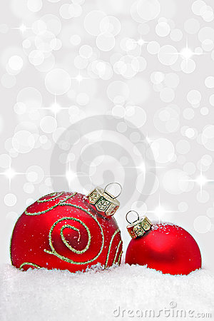 Two christmas baubles with bokeh light effect