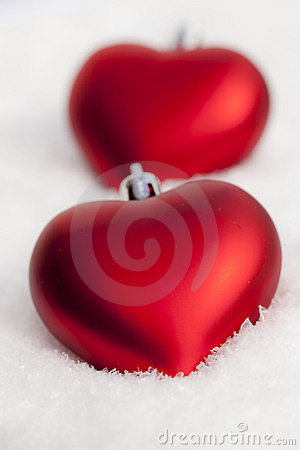 Two Christmas hearts in the snow