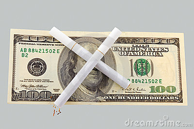 Two cigarettes crossed over one hundred dollar
