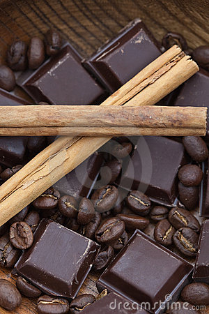 Free Two Cinnamon Sticks, Chocolate And Coffee Beans Stock Photography - 13457592