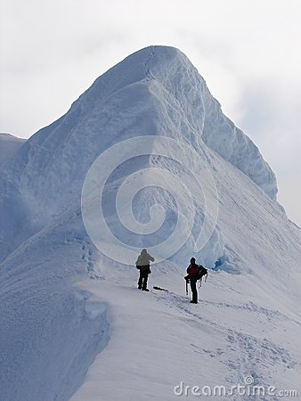 Two climbers on edge of crater volcano Beerenberg