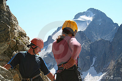 Two climbers looking down