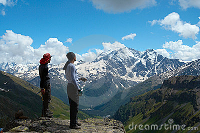 Two climbers looking at the mountains