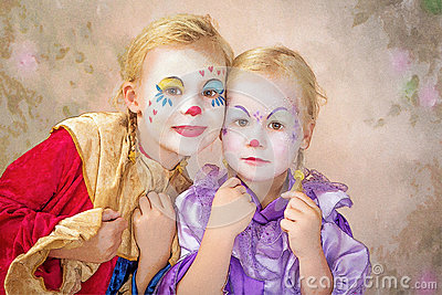 Two clown girls painted