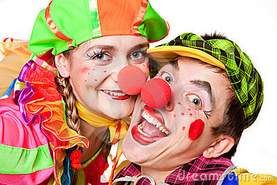 Two clowns smiling