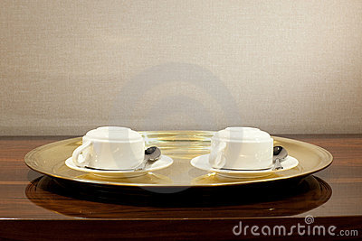 Two coffee cups on the tray