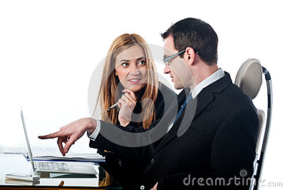 Two colleagues working together on a laptop computer